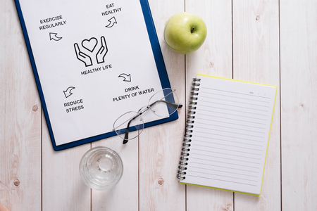 Top View Of A Meal Plan Concept On Wooden Desk