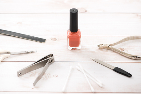 Nail care and manicure. Beautiful female hands with nail polish. Red manicure