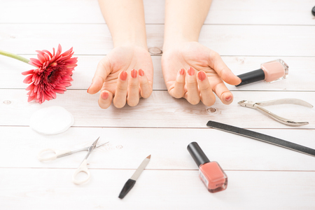 woman cover her nails with red varnish 写真素材