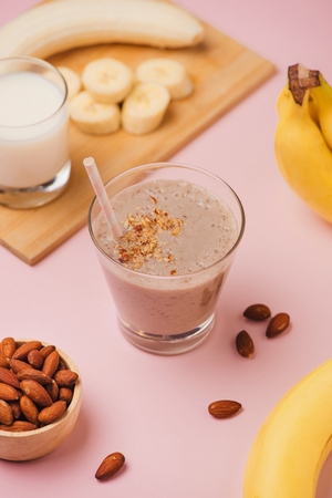 Fresh made Banana smoothie on pink background Stockfoto