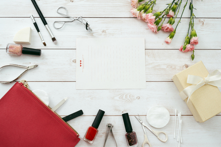 manicure set and frame red composition of nails tools. top view 写真素材