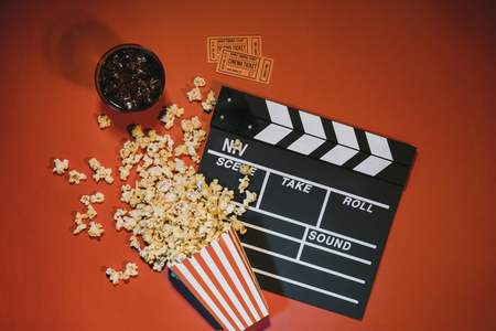 watching movie with popcorn on red background top view Stock Photo