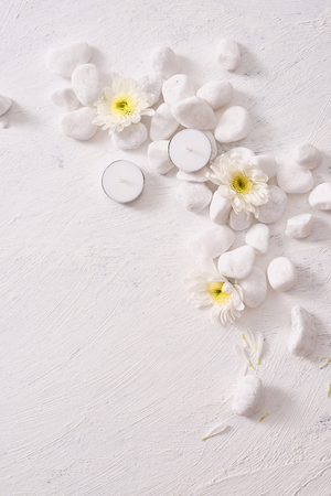 Spa setting with white flower ,candle on stone table Stock Photo