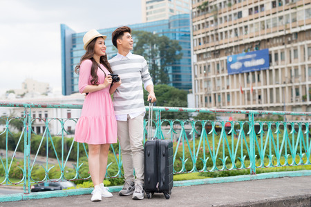 Happy Young Man And Beautiful Smiling Woman Traveling And Sightseeing City Attrcations. High Quality Image.