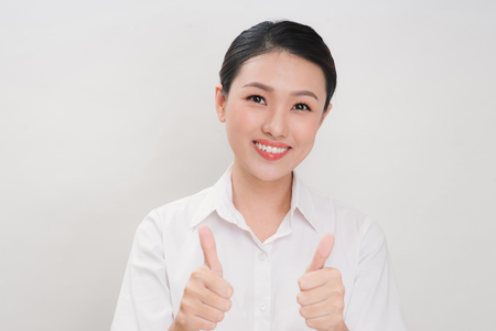 Asian business women are smiling and Thump up hand sign for working happy on white background