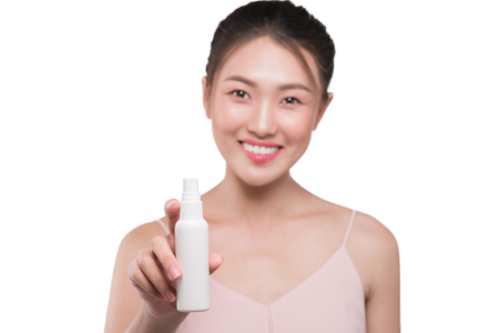 Beauty concept. Asian pretty woman with perfect skin holding cosmetic bottle Stock Photo - 104537964