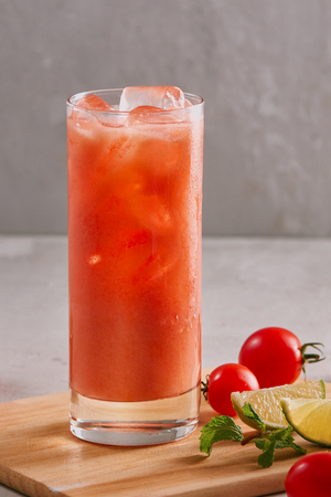 Glass of tomato juice with ice Фото со стока