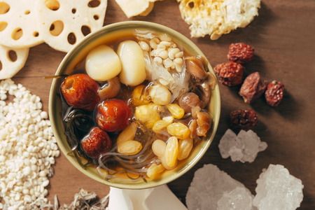 Well known and refresh asian dessert serves with longan, lotus foots, seaweed, fungus and jujube in the syrup can be found easily by the street in Chinatown.