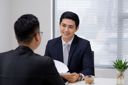 Job interview of two business professionals. Greeting new colleague