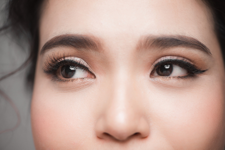 Closeup shot of beautiful asian woman eye with long eyelashes Foto de archivo