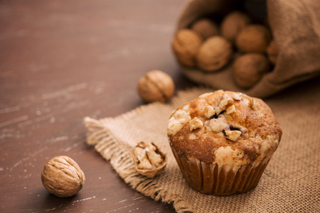 Tasty homemade walnut muffins on table. Sweet pastries