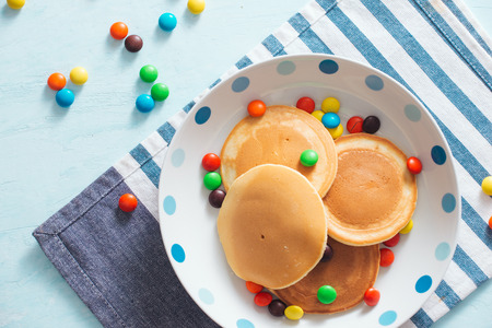 Childrens breakfast or dessert - pancake with colorful candies.