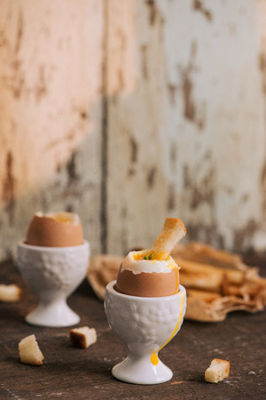 The yolk flows from boiled egg on toast