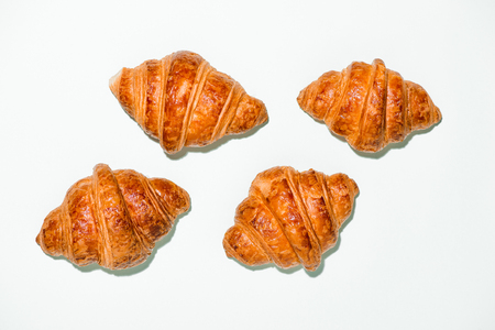 Breakfast with fresh tasty croissants on green background 版權商用圖片