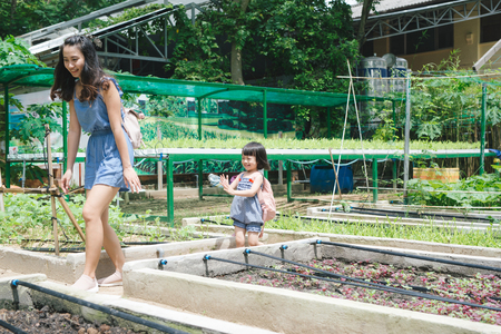 Mother and daughter engaged in gardening together