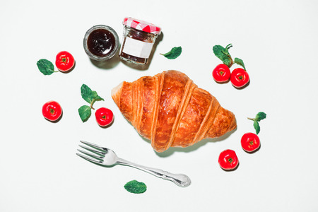 Breakfast with fresh croissants and jam, top view