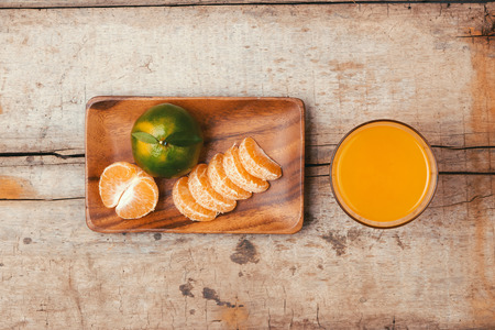 glasses of tangerines orange juice and fruits, high vitamin C Reklamní fotografie