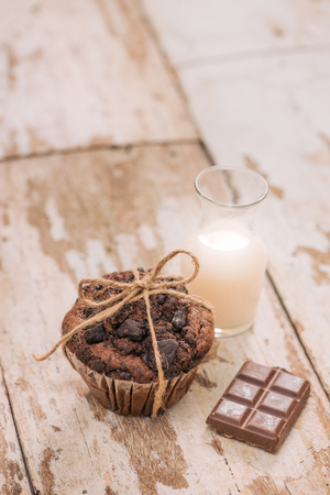 Dellicious homemade chocolate muffin on table. Ready to eat. Banco de Imagens