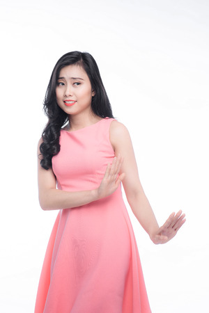 Young asian woman gesture annoyed isolated on white.