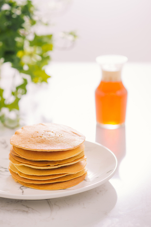 Stack of delicious pancakes on plate isolated on white Standard-Bild - 106382270