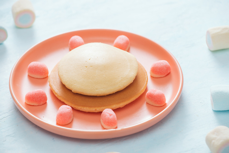 Childrens breakfast or dessert - pancake with marshmallow candies.