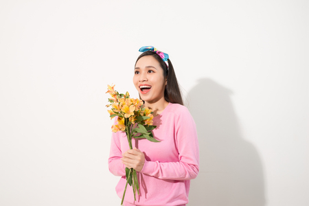 Lifestyle leisure international women's day concept. Close up portrait of lovely cute adorable excited delightful attractive woman holding flowers isolated on white background Imagens - 107461746