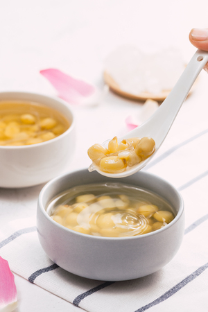 Vietnamese food, sweet lotus seed gruel, ingredients: lotus bean, sugar candy. this Vietnam dish for dessert or snack, very delicious, tasty, nutrition, make sleep well