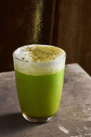 Matcha green tea latte in glass cup Stock Photo