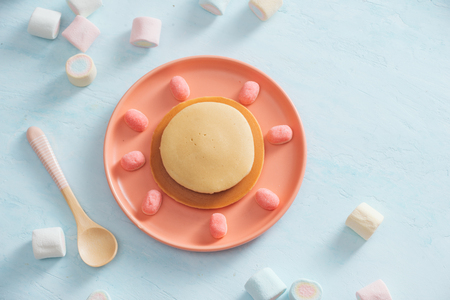 Childrens breakfast or dessert - pancake with marshmallow candies.