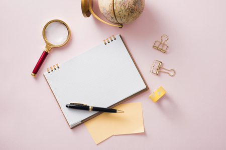 Modern mock up flat lay of notebook and stationery on pink background - Concept of creative work space
