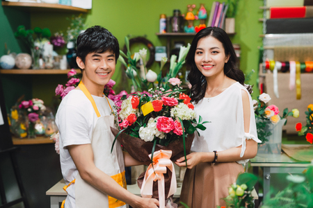 Young Asian Male Florist Have Conversation with his Customer in the Shop