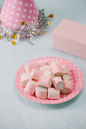 Birthday party items with marsh mallow on table