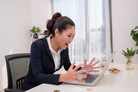 young Asia modern successful business woman with Computer and bitcoin in desk, bitcoin concept
