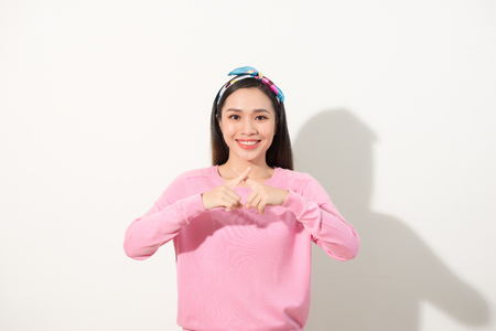 Pretty asian girl with fingers crossed to x shape, deny or forbidden sign, selected focus on hands Archivio Fotografico - 108117290