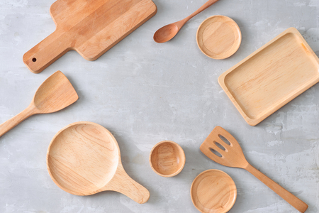 Set of wooden kitchenware on table Stock Photo