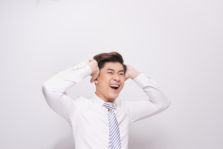 Shocked face of Asian man in white shirt on grey background. Banco de Imagens - 108498857