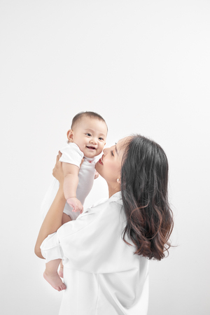 Motherhood and lifestyle concept. Smiling young mother with little baby at home