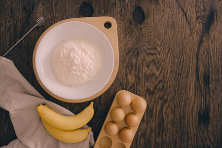Ingredients for butter cake on wooden table
