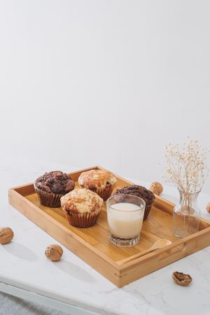 Breakfast with fresh homemade delicious muffins and milk.