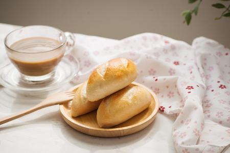 Morning breakfast with bread and coffee.