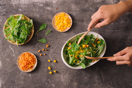 Fresh organic micro greens with carrot diced, food closeup Stock Photo