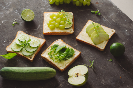 A variety of fruit and bread in a dark background