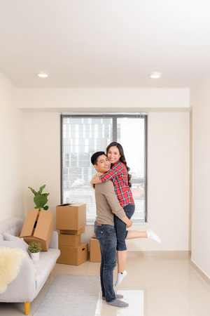 Happy couple just bought a new expensive apartment