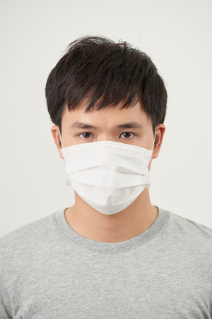 Stop the infection healthy man showing gesture stop of man wear protective mask against