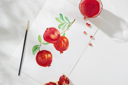 Tropical summer concept made of pomegranate fruit and hand drawing illustration.