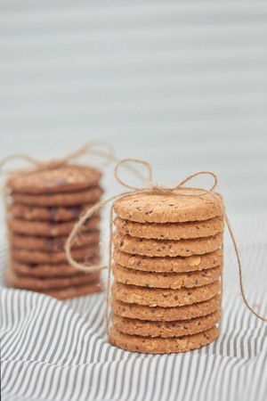 Cookie are stack and tied with twine. Delicious cookies on napkin background. Homemade cake. The nut cookie.