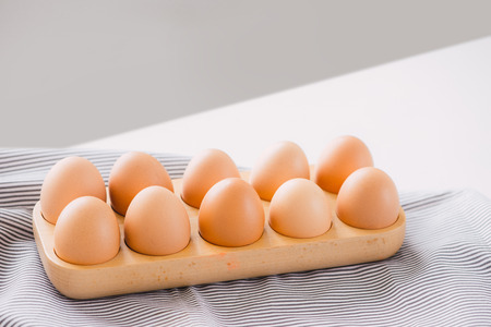 Eggs in a wooden tray ready cooking