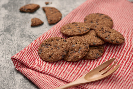 Chocolate biscuit cookies white napkin on stone table.