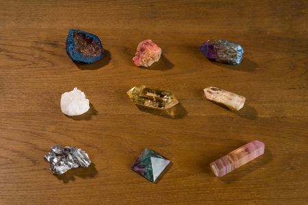 Collection of beautiful precious stones on wooden table. Stock Photo
