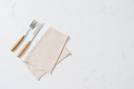 Napkin and cutlery on white background Imagens
